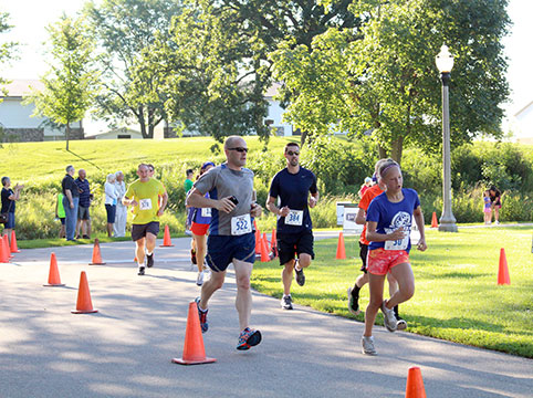 Several runners participating in the WaunaFest Run event (Waunakee, WI)