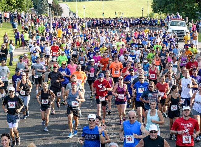 Large crowd of runners participating in the WaunaFest Run